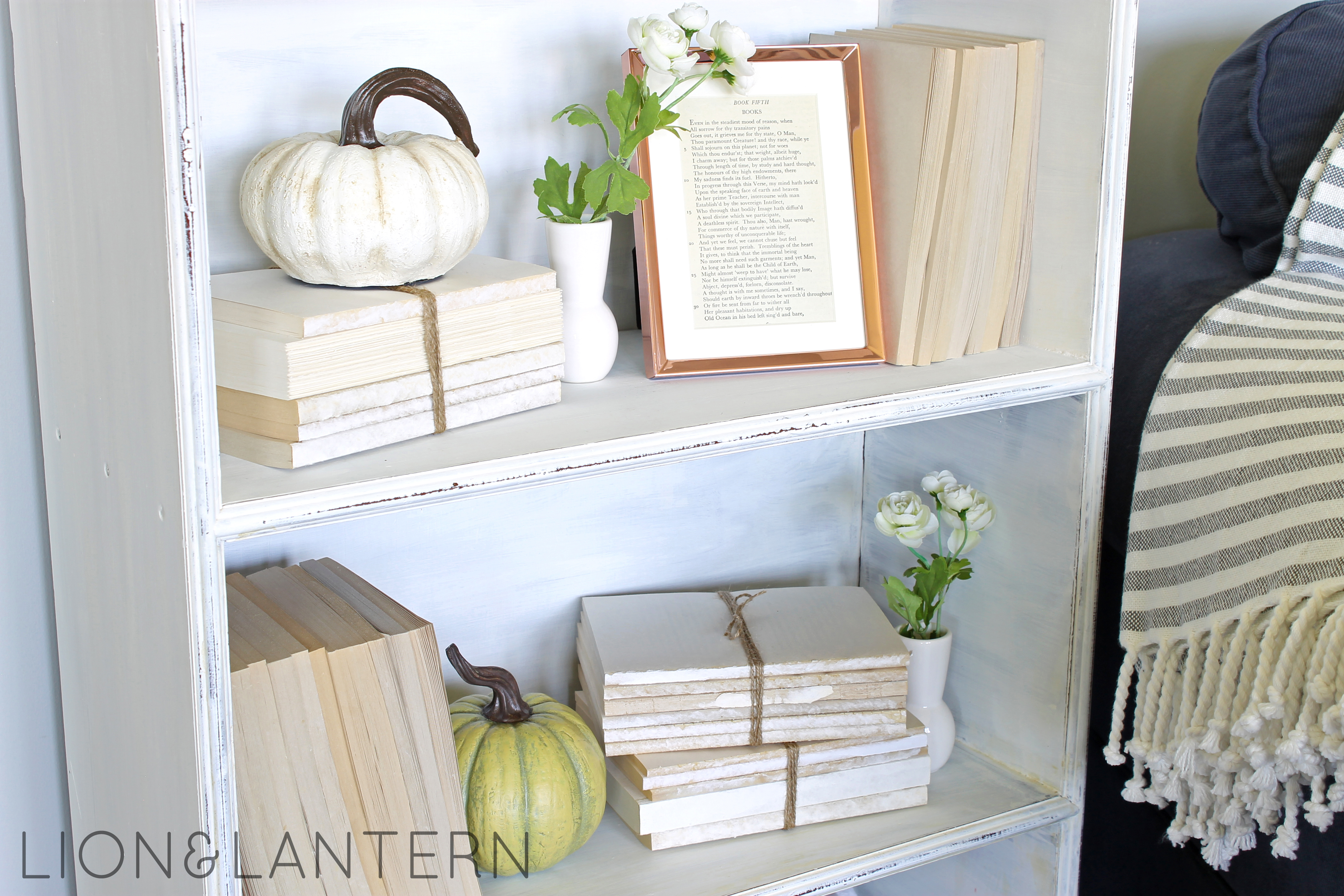 Cozy Autumn Bookcase Decor at LionAndLantern.com. Book bundle, neutral pumpkin, copper frame.