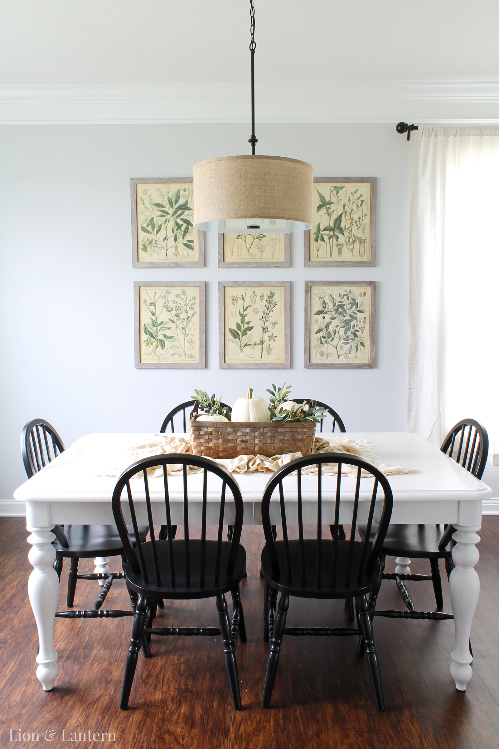 Fall Dining Room at LionAndLantern.com. Simple autumn decor, white pumpkins, greenery, candlesticks, farmhouse dining room, southern style.
