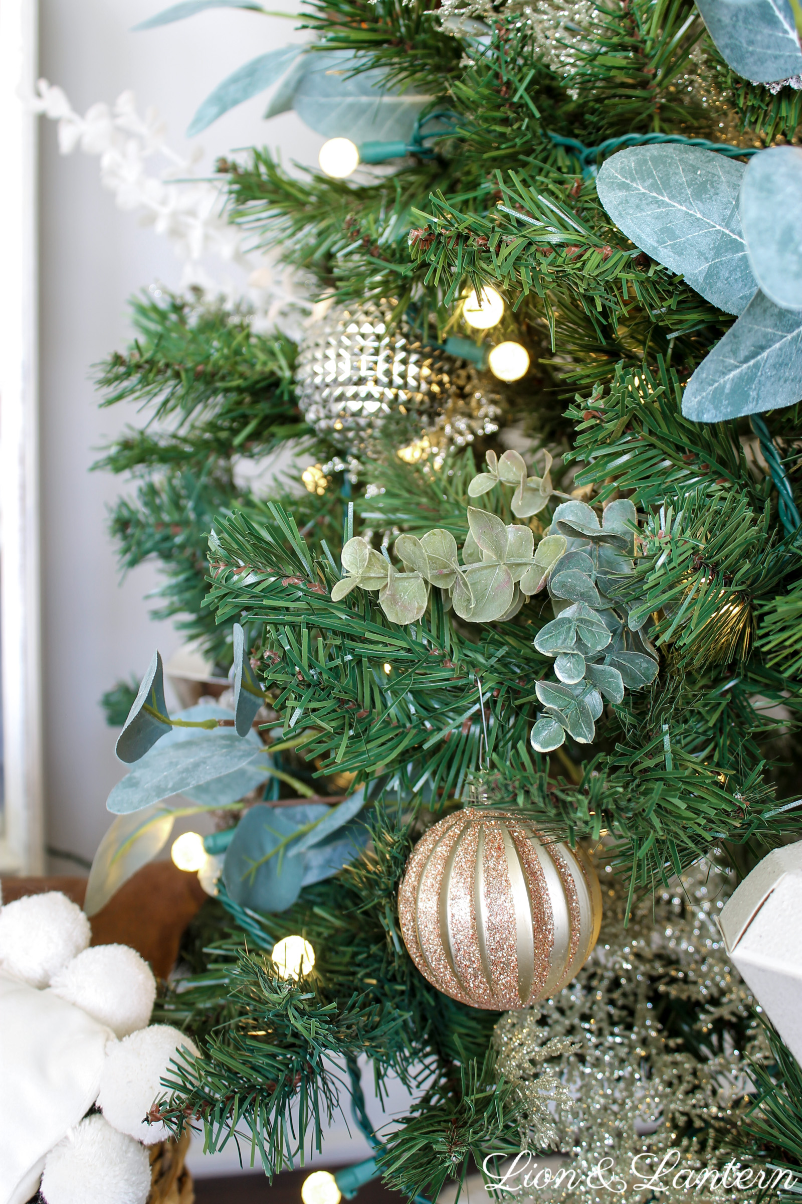 Simple Rustic Christmas Tree at LionAndLantern.com. Farmhouse Christmas, DIY Christmas decor, Christmas tree inspiration, eucalyptus, copper, gold, silver, pinecones