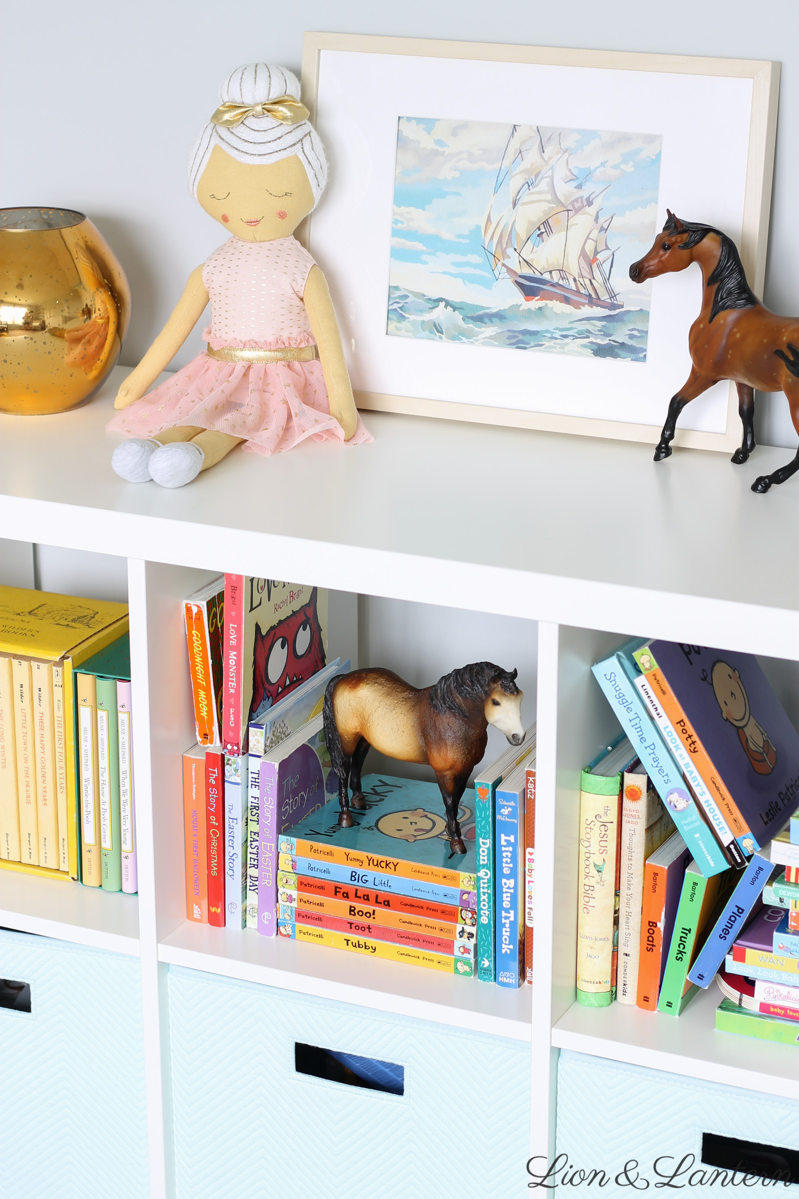 Narnia Inspired Sweet & Bright Nursery Tour at LionAndLantern.com | soft, pastel, modern, IKEA picture ledge, book ledge, rainbow baby, kids room, organized, clean