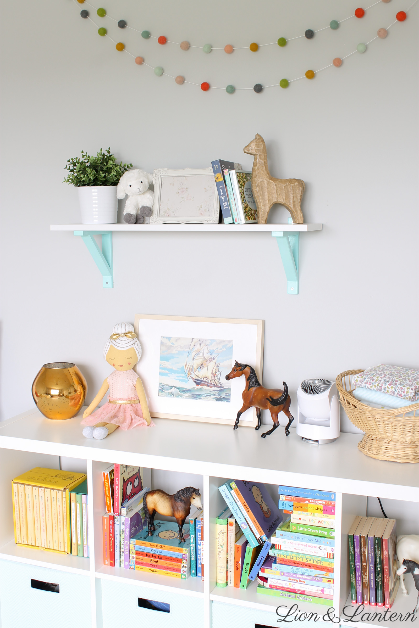 Narnia Inspired Bright & Sweet Nursery Tour at LionAndLantern.com | soft, pastel, modern, IKEA picture ledge, book ledge, rainbow baby, kids room, organized, clean