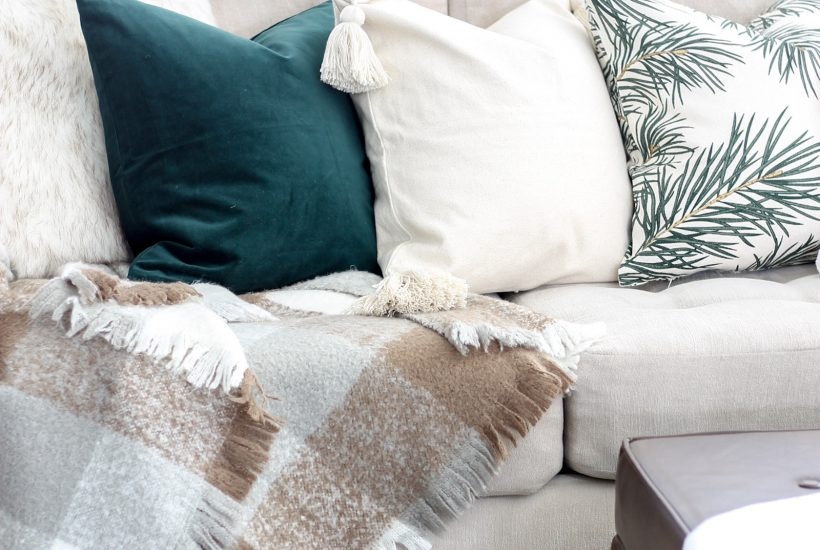 Modern Christmas Living Room at LionAndLantern.com | minimalist Christmas, Scandinavian Christmas, farmhouse Christmas, metallics, bronze, white, neutral living room, ladder shelf, throw pillow covers
