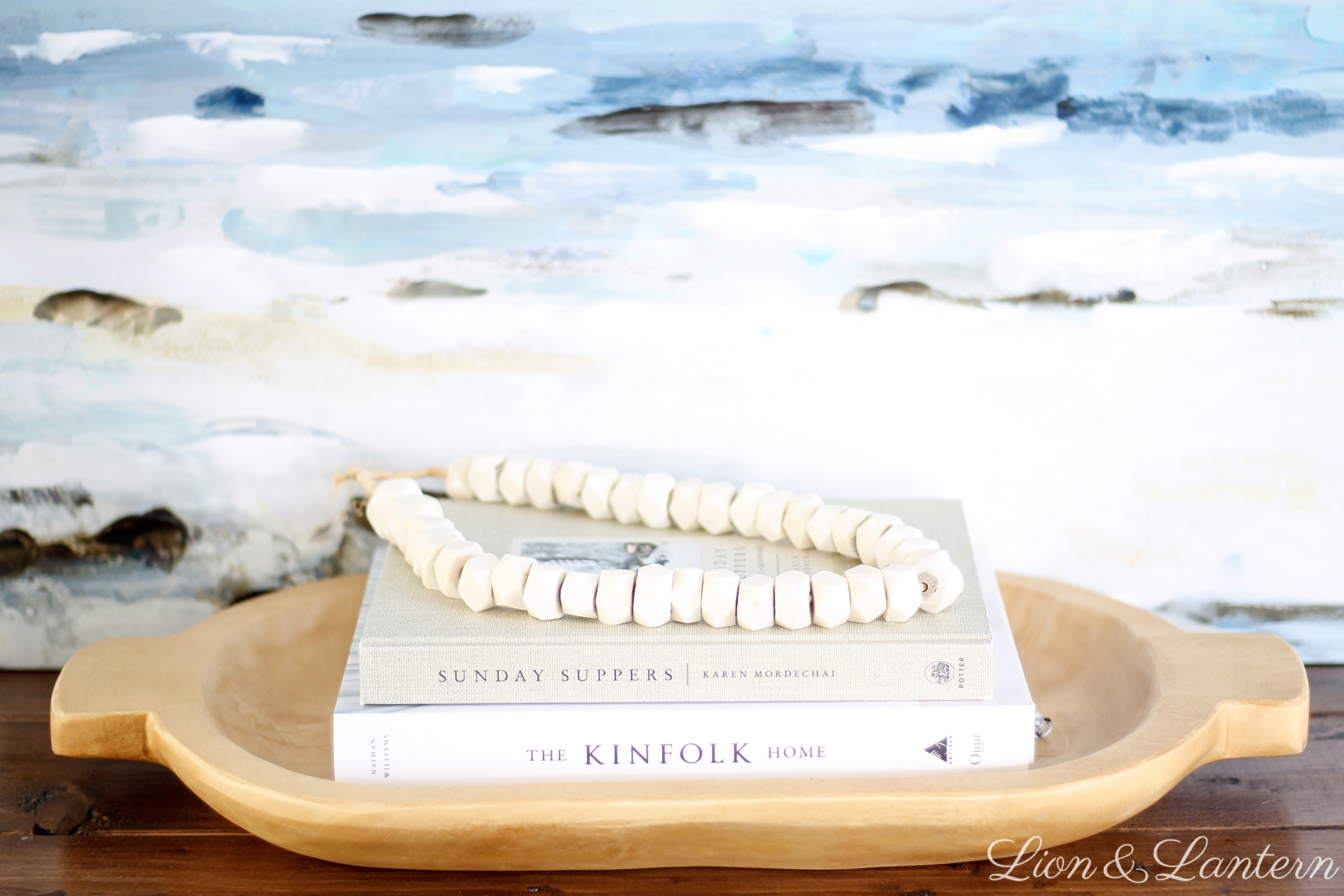 Easy Coastal Entryway Styling at LionAndLantern.com | coastal farmhouse, casual decor, modern, minimalist, bone beads, ocean painting, Ana White rustic x console