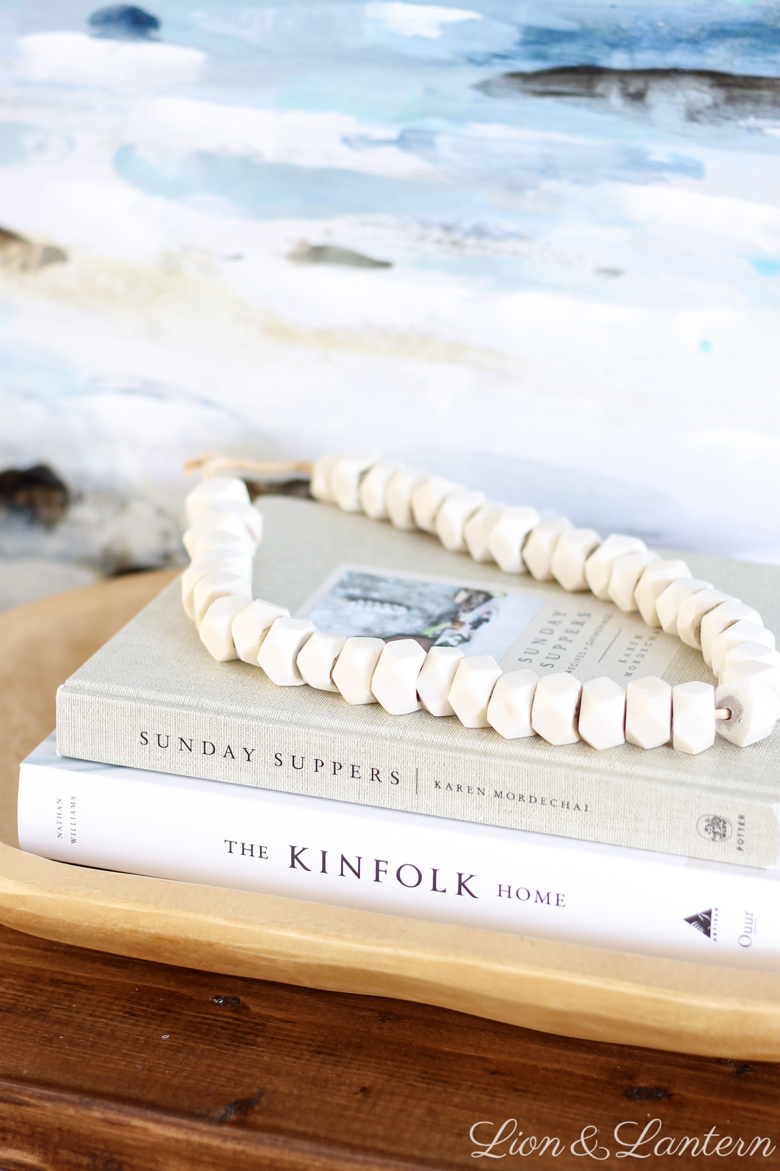Easy Coastal Entryway Styling at LionAndLantern.com | coastal farmhouse, coastal decor, modern, minimalist, bone beads, ocean painting, Ana White rustic x console