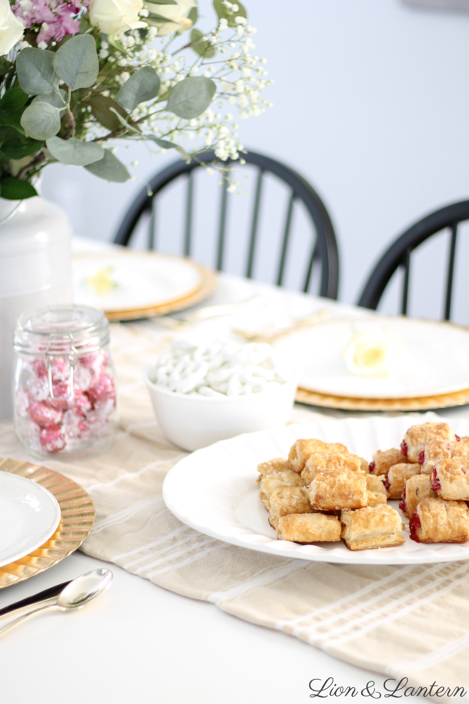 Sweet & Simple Valentine's Day Tablescape at LionAndLantern.com | farmhouse Valentine's Day, Valentine's brunch, Valentine's party, Valentine's luncheon, gold plate chargers, grocery store flower arrangement, budget party decor